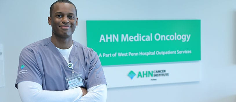 A health care professional smiles in a medical facility.