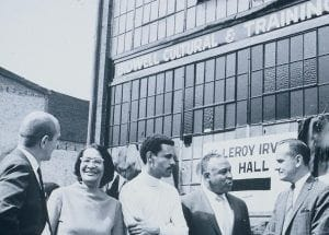 The founding of Bidwell Training Center in 1968, people stand outside a building