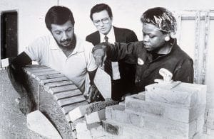 More teachers and students work in a trades class