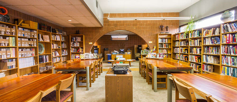 A library containing books and desks.