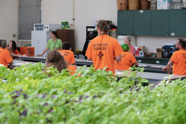 Bidwell's Horticulture Technology students learning in the greenhouse.